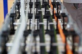 Výroba plněného řetězu - separační systém