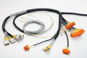 Cable harness with different connectors and end sleeves